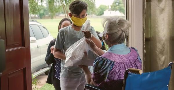 Children participating in volunteer food delivery program for the elderly