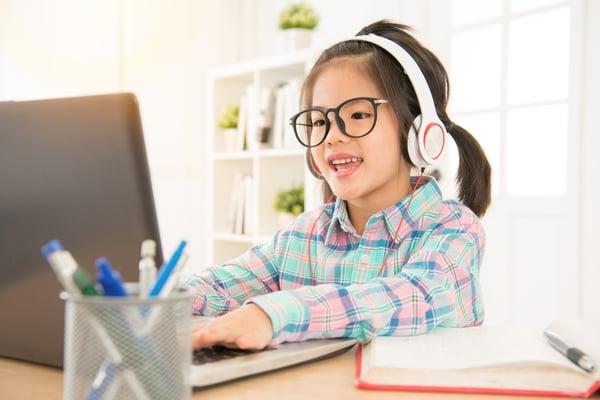 Elementary school student doing schoolwork on computer