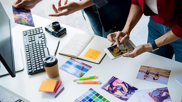 Branding strategists working at desk