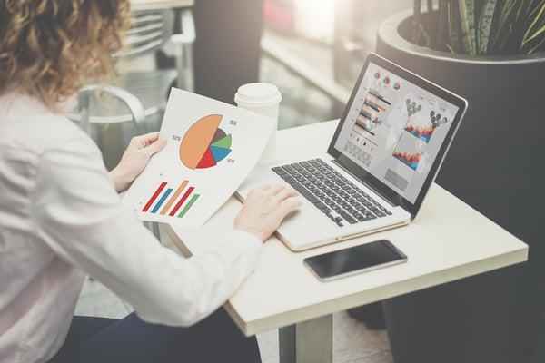 Woman analyzing charts